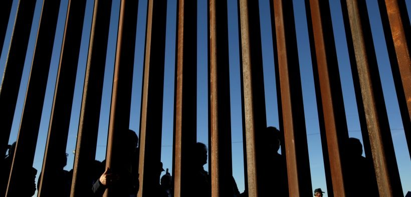People gather on the U.S. side of the border fence between Mexico and the United States during an inter-religious service against U.S. President Donald Trump's border wall, in Ciudad Juarez, Mexico February 26, 2019. REUTERS/Jose Luis Gonzalez -/File Photo
