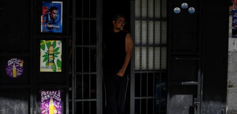 A man walks out a grocery store during an ongoing blackout in Caracas, Venezuela March 10, 2019. REUTERS/Marco Bello