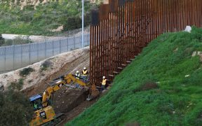 Construction workers in the U.S. work on a new section of the border fence as seen from Tijuana, Mexico February 18, 2019. REUTERS/Jorge Duenes