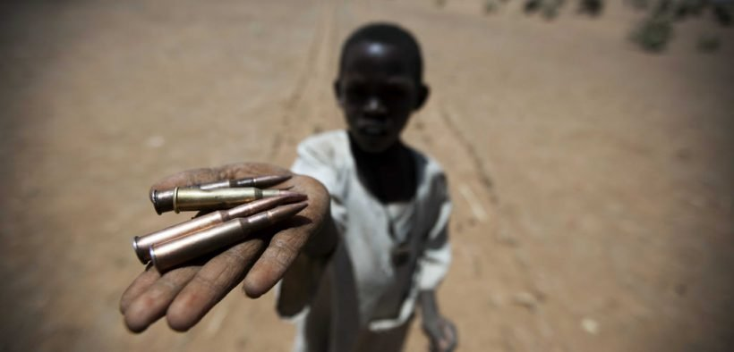 27 March 2011. Rounyn: A child collects bullets from the ground in Rounyn, a village located about 15 km north of Shangil Tobaya, North Darfur. Most of the population in Rounyn recently fled to camps for displaced people due to the clashes between the Government and the armed movements. Photo by Albert Gonzalez Farran / UNAMID
