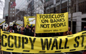 """Occupy Bank of America March 15, 2012, Occupy Wall Street targets BofA with a rally and march. Activists """"moved in"""" to a branch by setting up a sidewalk living room on the theory that 'the bank took our homes so we're moving in with them.' A half dozen people were arrested."""