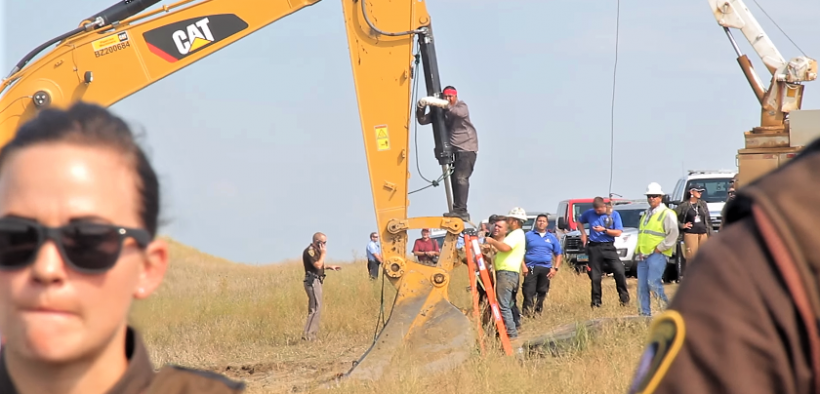 "August 31st, 2016 - North Dakota - The #NoDAPL water protectors who have come to stand with Standing Rock Sioux Tribe took non-violent direct action by locking themselves to construction equipment. This is ""Happy"" American Horse from the Sicangu Nation, hailing from Rosebud."""
