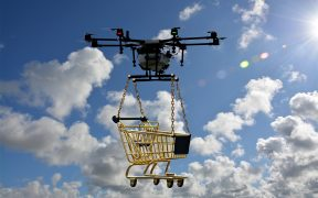 drone carrying a mini shopping cart