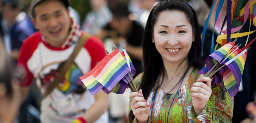 TOKYO -- A Japanese volunteer holds up rainbow flags for sale during the first annual Tokyo Rainbow Pride Parade in Yoyogi Park, Tokyo, April 29, 2012. (U.S. Air Force photo by Staff Sgt. Samuel Morse)