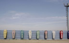 This is a monument for those who have died attempting to cross the US-Mexican border. Each coffin represents a year and the number of dead. It is a protest against the effects of Operation Guardian. Taken at the Tijuana-San Diego border.