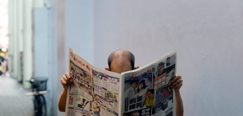 man reading the news in Chinatown, Singapore (Photo: digitalpimp)