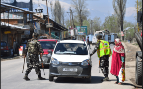 Indian paramilitary personnels restricting civilian vehicles near the Srinagar-Jammu highway in southern Pampore. (Photo: Kamran Yusuf)