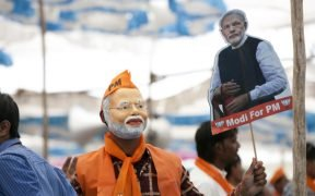 Man wears a Modi mask as Narendra Modi addresses rallies across Gujarat. (Photo: Prime Minister's Office, Government of India)