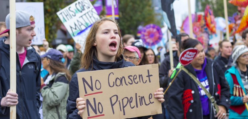 Protester holding sign stating No Pipeline, No Consent, during a Kinder Morgan Pipeline Rally on September 9th, 2017 in Vancouver, Canada. (photo: William Chen)