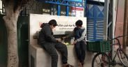 Two local children filling in water from one of the clean water points in the Maghazi refugee camp central Gaza Strip
