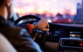 person driving a car (Photo: Pixabay)