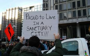 "Man holds a sign that says ""proud to live in a sanctuary city."" On Saturday, February 4, 2017 the March for Humanity was held in Philadelphia to show support for immigration and refugees, among other things."