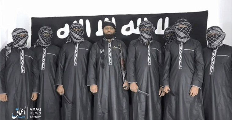 """Picture released by ISIS's Amaq News Agency showing the alleged attackers. Reads: """"Martyrdom Attacks by Islamic State militants shake Sri Lanka…the perpetrators of martyrdom attacks in Sri Lanka.""""\"""