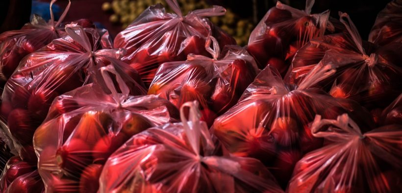 tomatoes in plastic bags