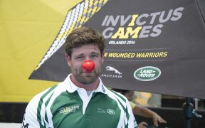 Noah Galloway, former United States Army Sergeant, poses for a photo wearing a red nose in support of Red Nose Day, a charity dedicated to helping children and having fun, after watching a swim event during the 2016 Invictus Games, ESPN Wide World of Sports Complex, Orlando, Fla., May 11, 2016.
