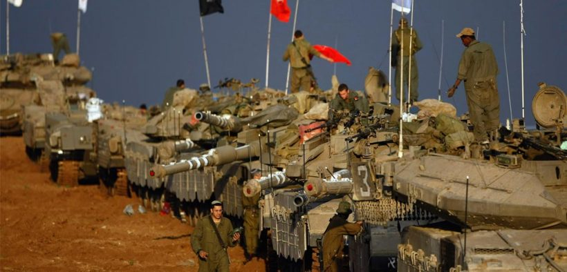 Scores of Israeli army tanks and armored personnel carriers are massed on December 29, 2008 near Israel's border with the Gaza Strip.