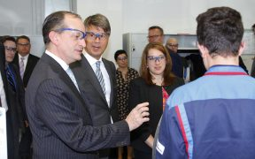 Secretary of Labor Alexander Acosta and BMW CEO Harald Krueger meet BMW apprentice at a technical apprentice training workshop
