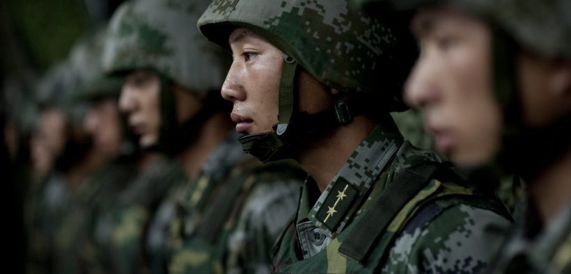 Soldiers of the Chinese People's Liberation Army 1st Amphibious Mechanized Infantry Division prepare to provide Chairman of the Joint Chiefs of Staff Adm. Mike Mullen with a demonstration of their capablities during a visit to the unit in China on July 12, 2011.