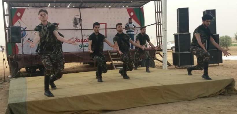A group of Palestinian Dabka folk dancers performed on stage. The Dabka dance, known to every Palestinian, is a part of a program of activities arranged by Great Return March organizers. (Photo Rami Almeghari)