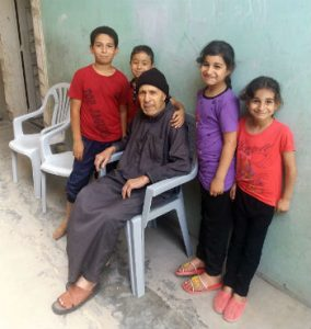 Yousef Albahnasawi and his grandchildren at his Nueirat family home