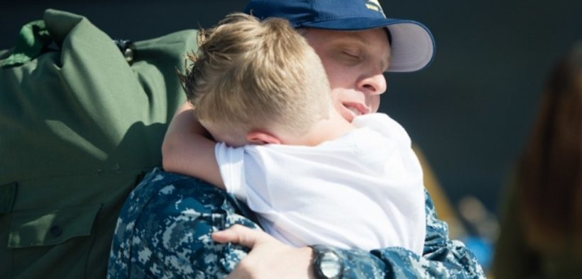 A sailor returning from a seven-month deployment reunites with his family. (U.S. Navy photo by Mass Communication Specialist 3rd Class Andre T. Richard)