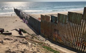 The U.S.-Mexico border wall extends into the Pacific Ocean with Playa Tijuana, Mexico to the south and San Ysidro, California to the north. The existing wall was built during the Clinton Administration. (Photo: Lauren von Bernuth)