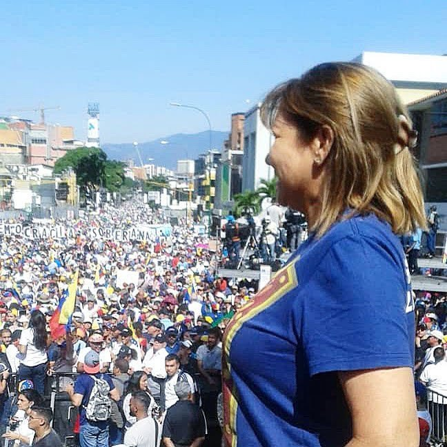 Yanet Fermin, with pro Juan Guaido rally in the background. (Photo: Yanet Fermin)