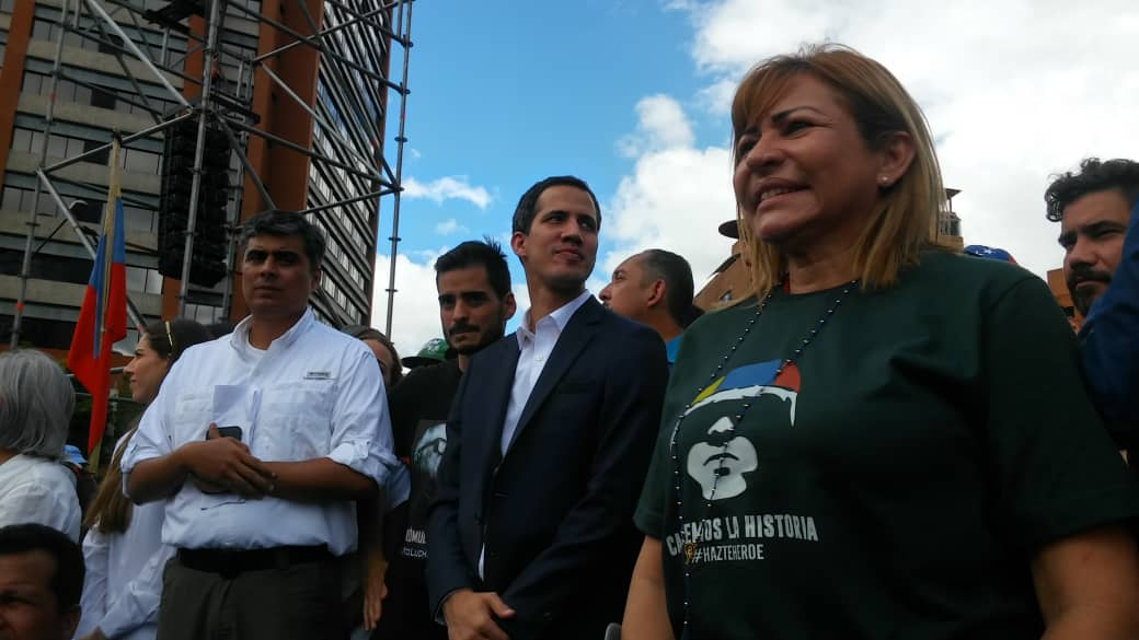 Yanet Fermin (right) on stage with Juan Guaido at a rally in support of Guaido. (Photo: Yanet Fermin)