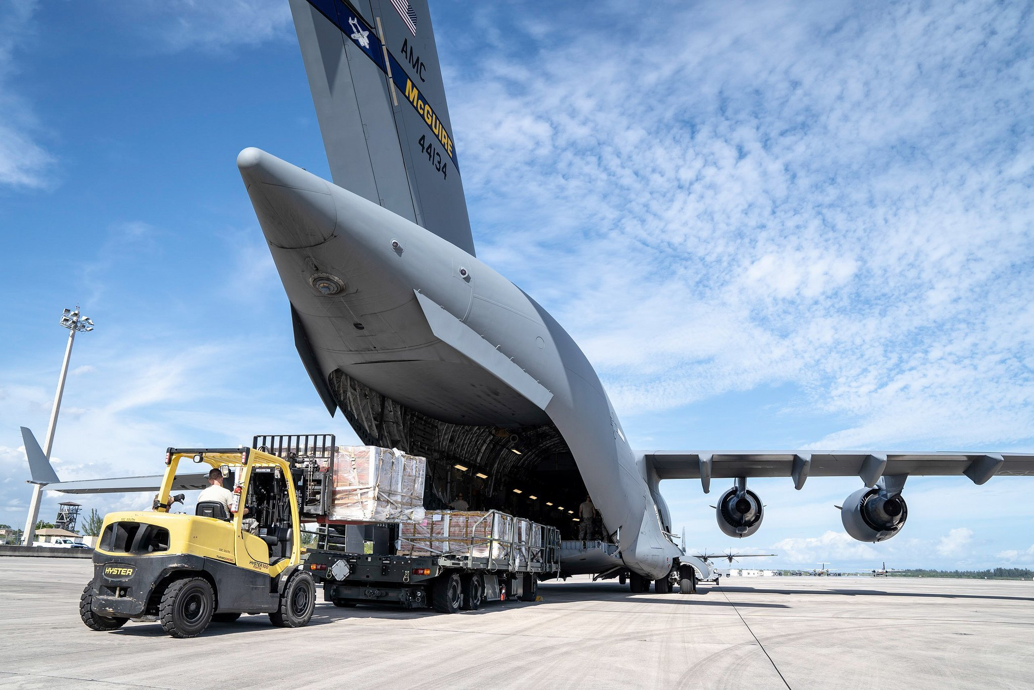 70th Aerial Port Squadron personnel load a C-17 Globemaster III cargo aircraft from Joint Base McGuire-Dix-Lakehurst, N.J., with humanitarian aid to be delivered to Cucuta, Columbia, for eventual distribution by relief organizations on the ground for Venezuelans Feb. 16, 2019. (U.S. Air Force photo/Tech. Sgt. Ben Hayes)