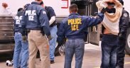 ICE Special Agents (U.S. Immigration and Customs Enforcement) arresting suspects during a raid.