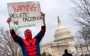 Facebook protester with Warning Delete Facebook sign, Washington DC