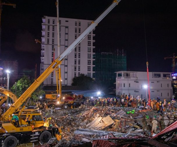 Rescue teams in Sihanoukville worked with excavators and backhoes to move rubble (Photo by CENTRAL).