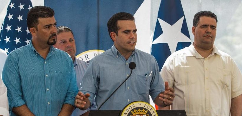 The Governor of Puerto Rico, Ricardo Rosselló addresses the media and survivors of Utuado, as part of the opening ceremony of the new bridge at the Río Abajo Community. The governor is accompanied by Ernesto Irizarry, Mayor of Utuado (left) and Carlos Contreras (right) Secretary of the Puerto Rico Department of Transportation. FEMA/Eduardo Martínez
