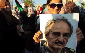Supporter holding a picture of rebel leader Khalifa Haftar