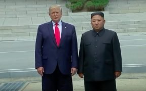 President Trump and Kim Jong Un shake hands at Korean DMZ at impromptu meeting.