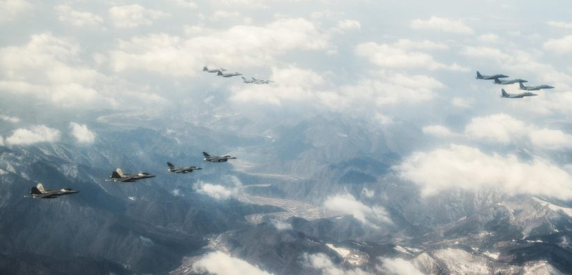 """Four U.S. Air Force F-22 """"Raptor"""" fighter aircraft from Kadena Air Base, Japan, fly over the skies of South Korea, in response to recent provocative action by North Korea Feb. 17, 2016. The Raptors were joined by four F-15 Slam Eagles and U.S. Air Force F-16 Fighting Falcons. The F-22 is designed to project air dominance rapidly and at great distances and currently cannot be matched by any known or projected fighter aircraft. (U.S. Air Force photo by Airman 1st Class Dillian Bamman/Released)"""