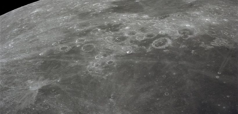 This 70mm handheld camera's view of the moon, photographed during the Apollo 16 mission's trans-Earth coast, features Mare Fecunditatis (Sea of Fertility) in the foreground with the twin craters Messier at the lower right. Nearer the horizon is Mare Nectaris (Sea of Nectar) with craters Goclenius and Gutenberg in between. Goclenius is located at approximately 10 degrees south latitude and 45 degrees east longitude.
