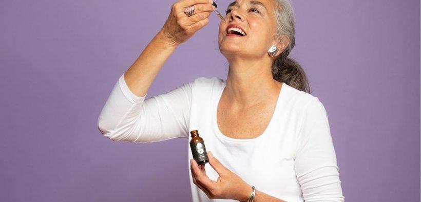 woman ingesting essential oil