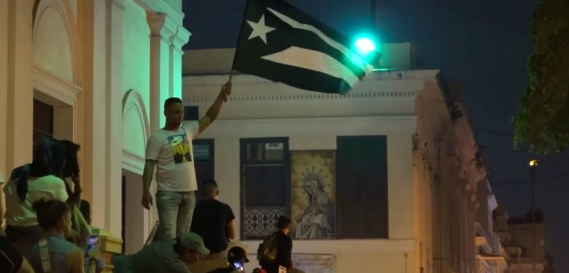 Protestors gathered outside in San Juan, Puerto Rico on July 15. (Photo: YouTube)