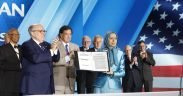 "Mayor Rudy Giuliani presents a statement signed by 33 U.S. dignitaries and former officials to Maryam Rajavi at the ""Free Iran – The Alternative"" gathering, June 30, 2018. (Photo: Maryam Rajavi)"