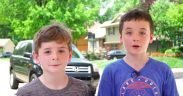 Ben and Carter Wilson, ages 10 and 8, set up a lemonade stand in front of their Overland Park, Kansas, home