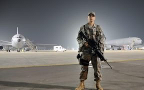 U.S. Air Force Airman 1st Class Frankie Piland watches over the flightline at an air base in the Middle East Jan. 31, 2010.