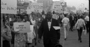 "African American and white Mississippi Freedom Democratic Party supporters holding signs reading ""Freedom now"" and ""MFDP supports LBJ"" while marching on the boardwalk at the 1964 Democratic National Convention, Atlantic City, New Jersey"