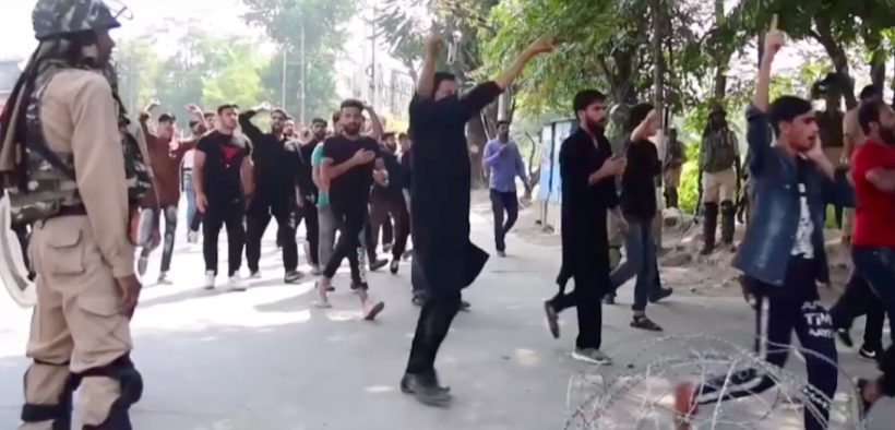 A Muslim procession in Kashmir is interrupted by government forces. (Photo: YouTube, AFP)