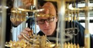 In this photo, IBM scientist Stefan Filipp, takes a closer look at the cryogenic refrigerator which will keep qubits are temperatures colder than the deepest parts of outer space.