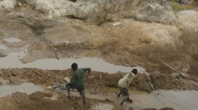 A gold mines in the Congo with two teenage miners.