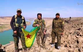 Fighters of the People's Protection Units of the Syrian Democratic Forces on the bank of the Euphrates east of the city of Raqqa in northern Syria.