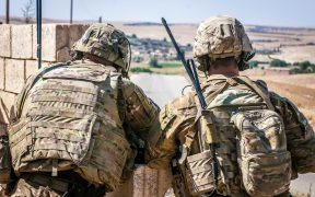 Two U.S. Soldiers keep an eye on the demarcation line during a security patrol outside Manbij, Syria, June 26, 2018.