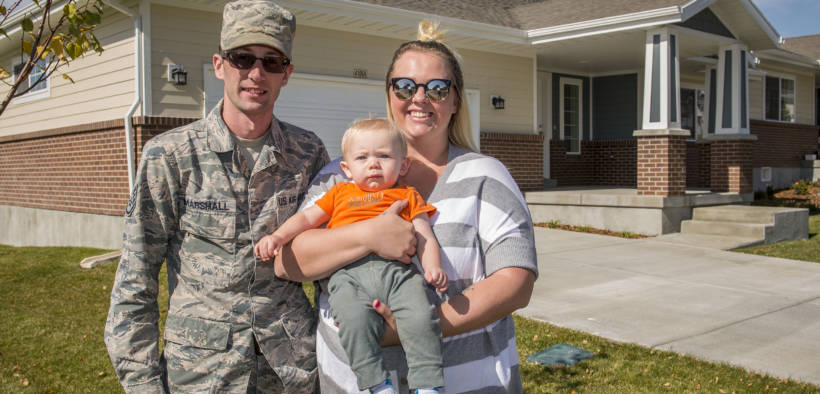 Staff Sgt. Austin Marshall, 84th Radar Evaluation Squadron, his spouse Heather, and 8-month-old son Law pose for a photo in front of their new base housing unit at Hill Air Force Base, Utah, Oct. 11, 2017.