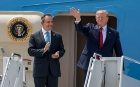 President Donald Trump (right) and Kentucky Gov. Matt Bevin greet supporters as they arrive at the Kentucky Air National Guard Base in Louisville, Ky., Aug. 21, 2019. Trump was in town to speak at an AMVETS convention and attend a fundraiser for Bevin's re-election campaign.